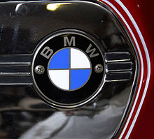 Closeup of BMW roundel badge on a part-painted and polished chrome fuel tank side panel