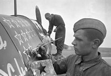 RIAN archive 247 A soldier drawing stars on the plane.jpg