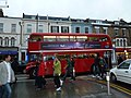 Red bus passing the junction of Compton and Wimbledon Hill Roads - geograph.org.uk - 3024210.jpg