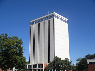 Louisiana Tech University - The 16-story Wyly Tower of Learning, named for the benefactors Sam Wyly and Charles Wyly, is the most prominent building on the Louisiana Tech campus in Ruston, Louisiana. It was designed by the Bastrop architect Hugh G. Parker, Jr. Though the Wyly Tower is the landmark campus structure, the university is planning to have the structure razed to make way for a revised library facility. The tower has been cited for lack of ventilation, asbestos, difficulty of providing fire protection, and stairwells do not exit to the exterior of the building.