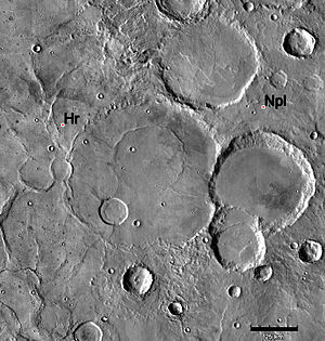 Noachian - Geologic contact of Noachian and Hesperian Systems. Hesperian ridged plains (Hr) embay and overlie older Noachian cratered plains (Npl). Note that the ridged plains partially bury many of the old Noachian-aged craters. Image is THEMIS IR mosaic, based on similar Viking photo shown in Tanaka et al. (1992), Fig. 1a, p. 352.
