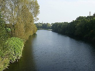 River Taff - The Taff flowing through Llandaff. Llandaff Rowing Club and a large weir lie in the distance