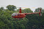 Robinson R44 Raven II 'G-SPTR' (35201406811).jpg