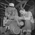 Rohwer Relocation Center, McGehee, Arkansas. In the motor pool repair section, George Baba and Tok . . . - NARA - 539383.tif