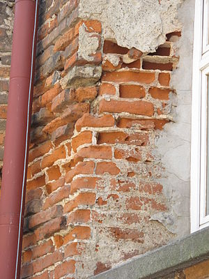 That Broken Plaster Over Faux Brick