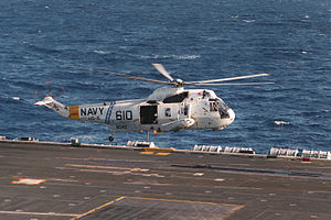 SH-3H HS-5 over hovers over USS Eisenhower (CVN-69) 1984.JPEG