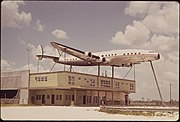 SUPER CONSTELLATION FUSELAGE DISPLAYED ABOVE BUILDING DEEP IN EVERGLADES - NARA - 544610