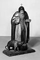 Saint Anthony, with emblem; a pig and carrying box. Wellcome M0013976.jpg