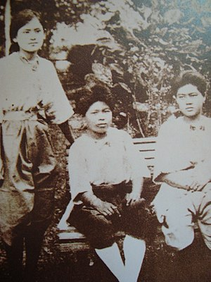 Srinagarindra - An older Sangwan (standing) with two friends at Satri Wittaya School.