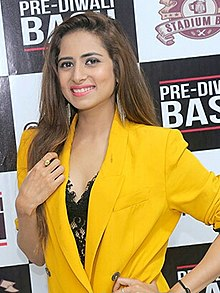 Sargun Mehta smiling at the camera.