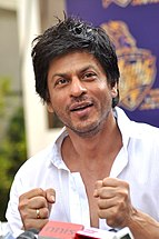 Shah Rukh Khan, smiling with fists clenched