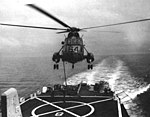 Sikorsky SH-3A Sea King is refueled in flight from USS Topeka (CLG-8) in the Gulf of Tonkin, in 1966.jpg