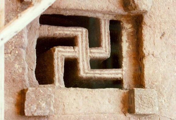 Skastika symbol in the window of Lalibela Rock hewn churches