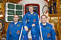 Soyuz TMA-06M crew members in front of the spacecraft.jpg