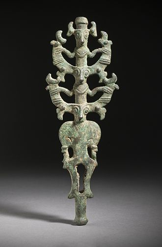"Luristan bronze - One of the distinctive ""canonical"" types of Luristan bronze, the ""Master of Animals standard"", here on two levels, showing ""zoomorphic juncture""; 8.5 inches high."