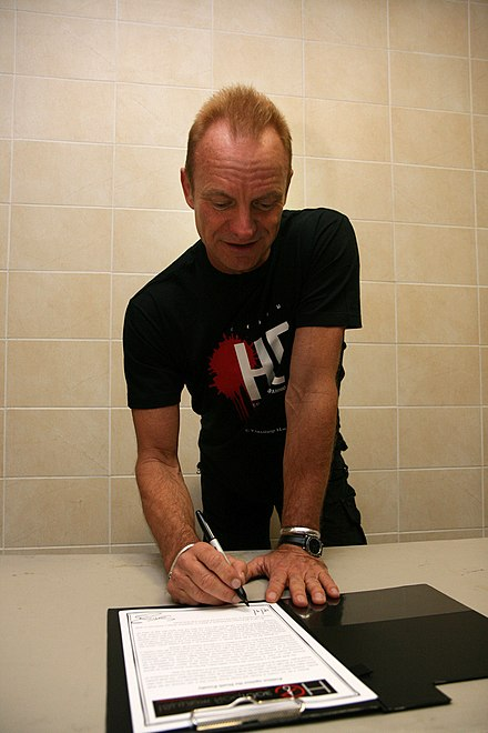 Citing a violation by the state on the right to life guaranteed in the Universal Declaration of Human Rights, in 2010 Sting signs the petition in Minsk against the death penalty in Belarus, the only European country that still practises it. Image provided by the Foreign and Commonwealth Office, a department of the British government. Sting (5071299947).jpg