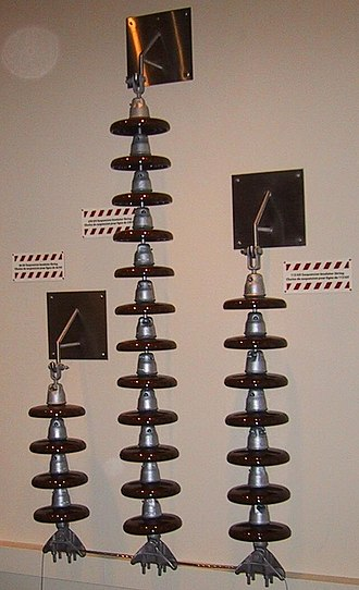 Strain insulator - High-voltage strain insulators used on 66 kV, 230 kV and 115 kV AC lines. The number of insulator skirts varies with voltage and atmospheric conditions.
