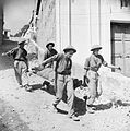 Stretcher bearers carry a wounded soldier to an advanced dressing station in Salerno, Italy, September 1943. NA7079.jpg