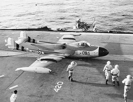 A battle-damaged de Havilland Sea Venom on HMS Eagle Suez Sea Venom.jpg
