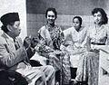 Tan Tjeng Bok, Sulastri, Dhiana, and Tina Melinda in a scene from Rela, Film Varia 2.4 (April 1955), p38.jpg
