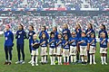 Team USA stands for the National Anthem before the match with young soccer players (48677558057).jpg