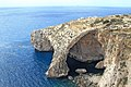 The Blue Grottoes with the tiny islet of Filfla in the background (26402363956).jpg