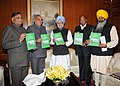 The Chief Minister of Haryana and Chairman of the Working Group on Agriculture Production, Shri Bhupinder Singh Hooda presenting a report to the Prime Minister, Dr. Manmohan Singh, in New Delhi on December 15, 2010.jpg