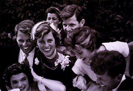 The newlyweds are surrounded by Jack's siblings on their wedding day in Newport, Rhode Island, 1953 The Kennedys by Toni Frissell, 1953.jpg