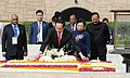 The President of the Socialist Republic of Vietnam, Mr. Tran Dai Quang laying wreath at the Samadhi of Mahatma Gandhi, at Rajghat, in Delhi.jpg