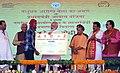 The Prime Minister, Shri Narendra Modi distributing the certificate to beneficiaries of the Pradhan Mantri Awas Yojana (Rural & Urban), at Shahanshahpur, Varanasi, Uttar Pradesh (2).jpg