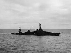 Torpedoed cruiser USS Chicago (CA-29) low in the water on 30 January 1943.jpg