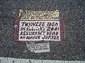 Toynbee tile in crosswalk at intersection of 13th and Market streets Philadelphia.jpeg