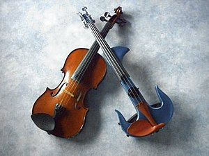 Electric violin - A traditional acoustic violin and a modern electronic violin from Marc Capuano