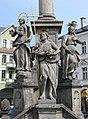Trutnov (okr. Trutnov), sloup se sousoším Nejsvětější Trojice, detail soch u podstavce, Jan Křtitel.JPG