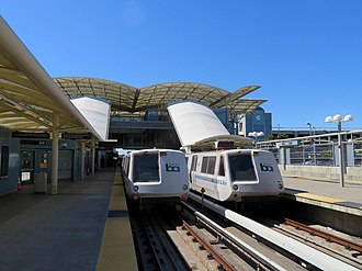 Richmond–Daly City/Millbrae line - Two BART trains at Millbrae station in 2018