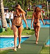 Two girls in g-string-bikinis on runway.jpg