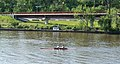 Two male rowers on the Anacostia River with Anacostia Trail - Washington DC.jpg