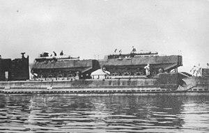 Type 4 Ka-Tsu - Two Type 4 Ka-Tsu armed with torpedoes on top of a submarine.