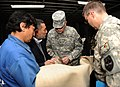 U.S. Army Brig. Gen. Gary Patton samples material that will be used to make boots (4299799127).jpg