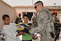 U.S. Army Maj. Edward Michels, with 1st Battalion, 178th Field Artillery Battalion, South Carolina Army National Guard, gives toys to Afghan boys during a humanitarian aid drop at Maihan Orphanage in Kabul 100831-A-GY802-084.jpg