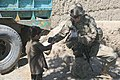 U.S. Army Spc. Brittany Kabe, right, with a female engagement team, gives candy to a child in Paktia province, Afghanistan, May 29, 2013 130529-A-CW939-047.jpg