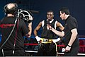 U.S. Army Spc. Zacchaeus Hardrick, center, a boxer representing the Army team is interviewed by a Pentagon Channel reporter, right, after winning his match at the 2011 Armed Forces Boxing Championship (AFBC) at 110215-F-SD522-107.jpg