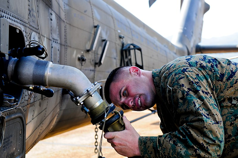 File:U.S. Marine Corps Cpl. John Fazio, a bulk fuel specialist with the Marine Wing Support Detachment based in Marine Corps Base Hawaii, attaches a fuel hose to a UH-60 Black Hawk helicopter while constructing 131118-A-UG106-227.jpg
