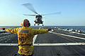 U.S. Navy Boatswain's Mate 2nd Class Tarick Birttingham directs a South Korean navy Mk99A Super Lynx helicopter as it takes off from the flight deck of the guided missile destroyer USS Lassen (DDG 82) March 18 130318-N-BX824-418.jpg