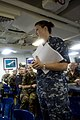 U.S. Navy Lt. Rachel Weidenann, foreground, answers questions for newly checked in nongovernmental organization volunteers and partner nation service members at a shipboard orientation aboard the amphibious dock 130603-N-WD757-096.jpg