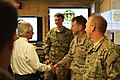 U.S. Sen. Bob Corker of Tennessee, left, shakes hands with U.S. Navy Capt. William Irwin while visiting Camp Integrity, Afghanistan, July 7, 2013 130707-N-QV903-024.jpg