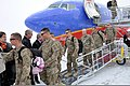U.S. Soldiers with the 818th Engineer Company (Sapper), North Dakota National Guard exit a plane and are greeted by North Dakota Gov 130322-A-YZ403-965.jpg