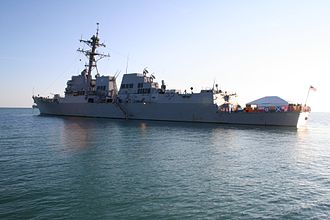 USS Nitze - USS Nitze seen from her port side, with signal flags displayed on the railing of her helideck