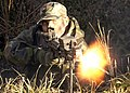 US Navy 021121-N-8726C-012 A Staff Sgt assigned to the 35th Security Forces Squadron, fires 7.62mm round.jpg