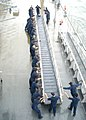 US Navy 030825-N-9860Y-008 USS Blue Ridge (LCC 19) deck department Sailors move one of the ship's brows in preparation for getting underway following a port visit.jpg
